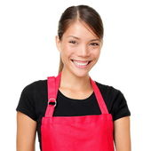 Smiling woman wearing apron — Stock fotografie