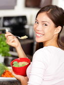 Woman eating quinoa salad — Stock Photo