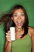Woman drinking from blank can — Stock Photo