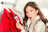 Shopping woman shocked over price — Stock Photo