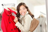 Shopping woman at clothes sale — Stock Photo