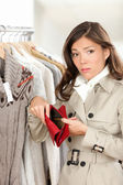 Woman shopper holding empty wallet or purse — Stock Photo