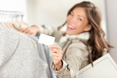 Shopping gift card sign woman — Stock Photo