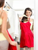 Shopper woman trying clothing dress shopping — Stock Photo