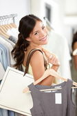 Shopping woman smiling happy — Stock Photo