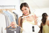 Woman shopping buying clothes — Stock Photo