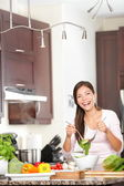 Kitchen woman making salad happy — Stock Photo