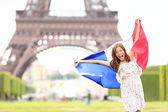 France - french flag woman by Eiffel tower, Paris — Stock Photo