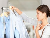 Shopper choosing clothes thinking — Stockfoto