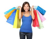 Shopper woman holding shopping bags — Stock Photo