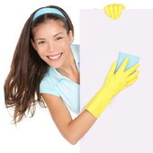 Cleaning woman showing sign — Stock Photo