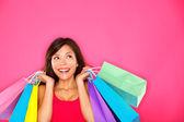 εμπορική γυναίκα που κρατά τσάντες αγορών — Φωτογραφία Αρχείου