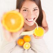 Orange juice drinking woman — Stock Photo