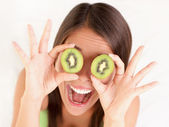 Kiwi fruit woman fun — Stock Photo