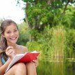 Student woman studying on campus park — Foto Stock