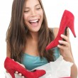 Woman getting shoes as gift — Stock Photo