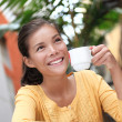 Woman drinking coffee in cafe outside — Stock Photo