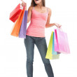 Shopping woman pointing full body isolated — Stock Photo #22925974