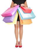 Comercial mulher segurando sacolas de compras — Fotografia Stock