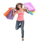 Happy shopping woman running — Stock Photo