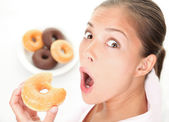 Funny woman eating junk food — Stock Photo