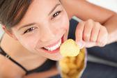 Beautiful woman eating junk food — Stock Photo