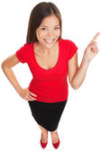 Pointing showing woman smiling cheerful — Foto Stock