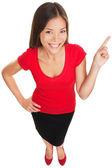 Wskazujące kobieta wyświetlone uśmiechający się wesoły — Zdjęcie stockowe