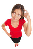 Confused woman scratching her head — Stockfoto