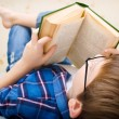 Little boy is reading a book — Stock Photo #21297077