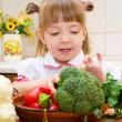 Portrait of a happy little girl with vegetables — Stock Photo