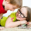Stock Photo: Girl hides candies from her brother