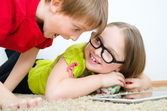 Girl hides candies from her brother — Stock Photo