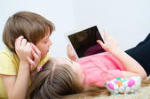 Children watching tablet — Stock Photo