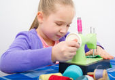 Girl sewing — Stock Photo