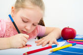 Portrait of girl drawing with pencils — Stock Photo