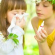 Girl is blowing her nose outdoors — Stock Photo #24925665
