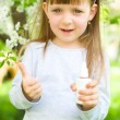 Girl holding nasal spray,showing thumbs up — Stock Photo #24925679