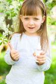 Girl holding nasal spray,showing thumbs up — Stock Photo