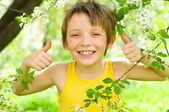 Portrait of a boy showing thumbs up — Stock Photo