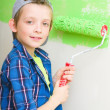 Boy is painting interior wall of home — Stok Fotoğraf #25144471