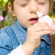 Stock Photo: Girl spraying nose