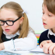 Schoolchildren writing at school — Stock Photo