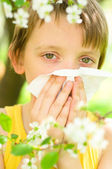 Little boy is blowing his nose — Stock Photo