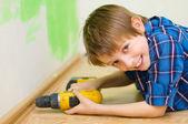 Boy worker installing plinth — Stock Photo