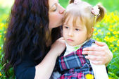 Mother kisses daughter — Stock Photo