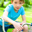 Boy riding bicycle — Stock Photo