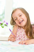 Girl writing — Stock Photo