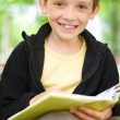 Stock Photo: Boy with book