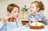 Children drinking tea — Stock Photo